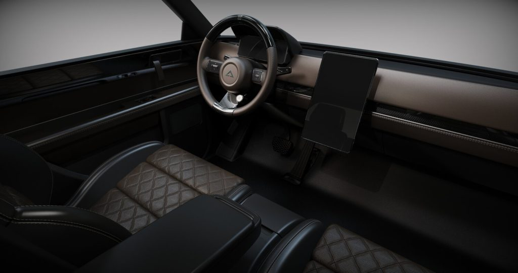 תא הנוסעים וסביבת הנהג של הוולף החשמלי של אלפא מוטור, בצבע שחור עם מסך במרכז הרכב